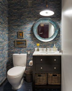 """Mirror: Gordon Mirror from Arteriors, vanity: Hutton Washstand from Restoration Hardware, faucet: Henry  from Waterworks, wallpaper: Twigs """"Pheasant"""""""