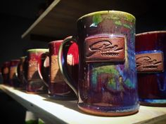 @stowecraftgallery Loving the purples, greens & blues on these Burning Mud Pottery mugs  each holds a full 16oz of your favorite hot beverage ☕️ #stowecraftgallery #mugs #handmade #handcrafted #pottery #ceramic #gothicglaze #glaze #vermont #vermomtartist #burningmudpottery #coffee #tea #local #shoplocal
