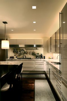 There are many features of note in this outstanding kitchen. The high gloss cabinetry with extra long stainless steel handles, the lighting