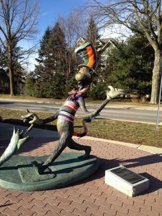 The Cat in the Hat outside Nichols Library is all decked out today! He has been yarn bombed and he is looking pretty spiffy. · Naperville Public Library's photos