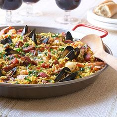 Traditional Spanish Paella | Nourishing, vibrant, and served without pretension, paella has held a place of honor and practicality in Spanish homes for centuries. If mussels aren't your favorite, you can easily substitute littleneck clams in their place--just be sure to thoroughly scrub the clams' shells in cold water before using. To round out the meal, choose a good Spanish red wine from the Rioja region, grab a crusty baguette, and serve with a light salad.