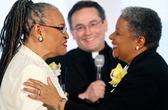 Revs. Darlene Garner and Candy Holmes, March 9, 2010  Washington, D.C.  They were among the first same-sex couples legally married in Washington, D.C. Both Garner and Holmes are ministers of the Metropolitan Community Churches. Also in the picture is officiant, Rev. Dwayne Johnson. The wedding took place at the national offices of the Human Rights Campaign.