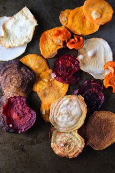 Discover recipes for veggie chips of all kinds that you can easily make in your oven at home. Learn recipes for chips made from root vegetables, kale, squash, sweet potatoes, and more. Healthy Chips, Healthy Snacks, Healthy Recipes, Eating Healthy, Baked Vegetables, Root Vegetables, Veggies, Veggie Chips, Baked Vegetable Chips