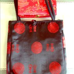 Chinese-style handbag, red and black. Beautiful, never used. Bought as a gift. Knotted closure in front. Lined and includes 2 zippered compartments inside to fit valuables. Bags