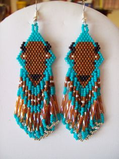 Native American Beaded Turquoise Buffalo by BeadedCreationsetc. $25.00, via Etsy.