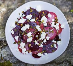 A simple side salad of vibrant beets with salty feta cheese and a lemon vinaigrette: the combination of the feta, with the crunchy seeds is just perfect (didn't use heirloom beets though) Healthy Vegan Snacks, Healthy Salad Recipes, Vegetarian Recipes, Eating Healthy, Salad Recipes Video, Bbc Good Food Recipes, Muesli, Sin Gluten, Beetroot And Feta Salad