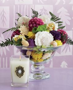 This will make an elegant centerpiece for your spring table. Fill a glass bowl with the contents of Spring bags and add a cube candle.