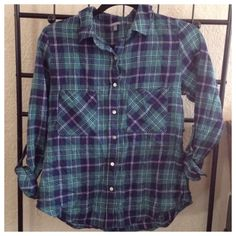 Green Plaid Shirt. NWOT, never worn. Too small in the shoulders for me. Buttons down the front, two chest pockets, a collar, and can be worn with sleeves rolled up with button that holds it in place. Charlotte Russe Tops Button Down Shirts