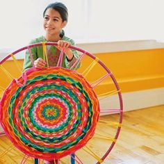 How to make a rug w/ a hula hoop.  Here is the perfect craft to recycle t-shirts - make a woven rug using a hula hoop! There are other ideas too so check them all out, and the directions, at Family Fun.
