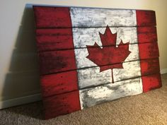 Vintage looking Canada flag art painted wood pallet sign. Great for the cottage.Rustic Vintage looking Canada flag art painted wood pallet sign. Great for the cottage. Painting On Pallet Wood, Pallet Wall Art, Wood Pallet Signs, Wooden Pallets, Pallet Boards, Pallet Flag, Wood Flag, Wooden Signs, Wood Crafts