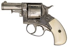 From the other side..A nickle plated and engraved Webley and Scott British Bulldog revolver with ivory grips, late 19th century.