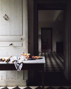 moody kitchens with checkerboard floors