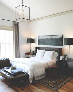 This moody spot is my kind of bedroom. Love the contrast: dark masculine vibes combined with light airy whites. So lovely. Want to see it as our next room redo? Like it to vote!   Melanie DeFazio #CopyCatChic