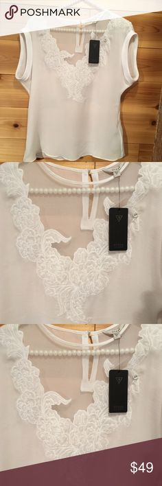 SHEER WITH FLORAL EMBROIDERY NEW WITH TAG...Sheer Guess blouse with a partial lining, a beautiful floral embroidery around the neck. Very pretty with jeans but a great blouse for the office. Guess Tops Blouses
