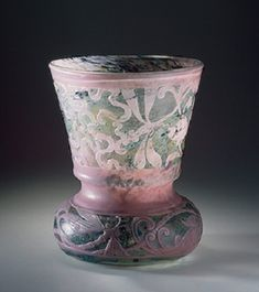 Vase with Ribbons, Floral Motifs and Dragonflies. Workshop of Emile Galle, France, Nancy. Circa 1889. Two-layered glass; mould-blown, engraved and carved. H: 21.5cm, diam: 17.8cm. Hermitage Museum.