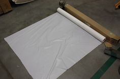 Plastic tablecloth roll - also good as a drip cloth or drying surface, and it's recyclable!