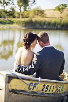 Wedding Couple In Boat from rusticweddingchic.com