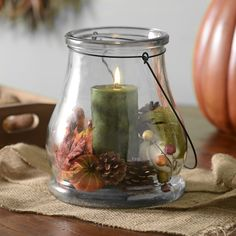 Fill your lantern with pieces of fall. We recommend candy, fake leaves, or pinecones!
