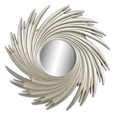 Liquid Gold. Bold spirals of pale gold encircle a smaller round mirror on the 39-inch Gold Swirl mirror. The beveled, silver-backed mirror offers shine and energy wherever it's placed and the neutral hue ensures that this piece will blend beautifully, no matter your style.