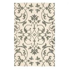 Hand-tufted New Zealand wool rug with a scrolling vine motif.   Product: RugConstruction Material: New Zealand woolColor: Ivory and greyFeatures:  Hand-tuftedMade in India Note: Please be aware that actual colors may vary from those shown on your screen. Accent rugs may also not show the entire pattern that the corresponding area rugs have.Cleaning and Care: Professional cleaning recommended