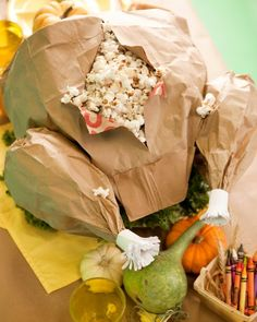 Paper-Bag Turkey - This simple, popcorn-filled paper-bag turkey from One Charming Party crafter Sara Westbrook is a perfect centerpiece for a children's Thanksgiving table. If the popcorn is buttered or cooked in oil, use plastic bags or wax paper to line the paper bags.