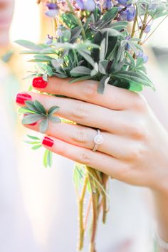 red nails + diamond ring