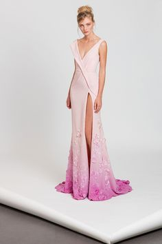 Moroccan crepe wrap dress ombré in pastel pink and magenta, featuring a side slit and flowery appliques on the hemline.