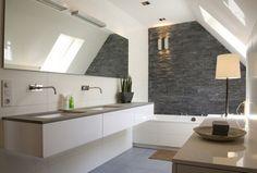 mooie badkamer met natuursteen grijs