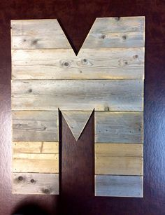 """We make rustic letters from repurposed wood.  They may be purchased in 12"""", 16"""" & 20"""" heights.  A perfect gift!"""