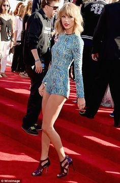 Taylor Swift in a high-cut playsuit by designer Mary Katrantzou at the 2014 VMAs http://dailym.ai/1oluLIj