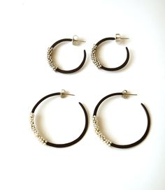 Earrings made with oxidized sterling silver, seed pearls, silver beads, and 18k gold. By Maya Kini, Gallery Lulo.