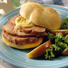 Tender, succulent slices of mustard-crusted boneless leg of lamb served on a kaiser roll./