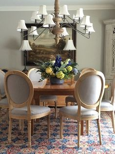 Add elegance to your dining room with a round table and these beautiful linen upholstered and  white washed carved wood dining chairs from HomeGoods.  Comfortable and stylish these neutral light gray chairs don't need to stay in the dining room. So pretty that they can stand alone as an accent chair or paired with a desk.: