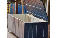 Great way to use old pallets.  Even better way to hide ugly, obnoxiously blue recycling bins.