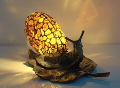 """Amber Snail -Table lamp. About 7"""" shade hade hand made of natural Baltic amber. 13"""" long brass base. Stained glass lamp. Bedside lamp."""