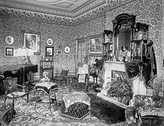 """""""Terceira House, Aigburth Drive, Sefton Park, Liverpool. Victorian interior showing the drawing room. Potted ferns occupy the fireplace and there is a portrait of Queen Victoria on the wall. Photographed in September 1891 by H Bedford Lemere."""""""