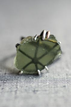 Space Rings www.varianceobjects.com from $440.00 Jewelry from out of this  world. Genuine meteorite Mossy green moldavite