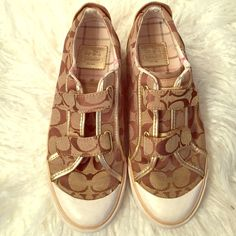 Authentic Coach Tennis Shoes Size 7 1/2 Pre owned Coach tennis shoes in great condition. Normal wear and tear and minor stains shown on white parts but nothing major. These are size 7 1/2. Coach Shoes Sneakers