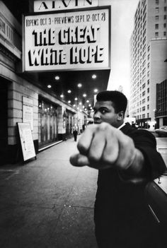 Muhamed Ali in front of the movie theater showing The Great White Hope. Great movie by the way.