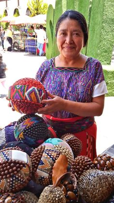 Colorful crafts Spheres made with seeds, grains and textiles from DECOESFERAS/ esferas coloridas hechas a mano con semillas, granos y textiles artesanías de Guatemala CA