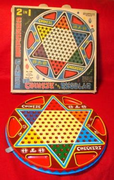 CHINESE CHECKERS.....this is one of a few board games we played as children.  We had very few and treasured all of them.