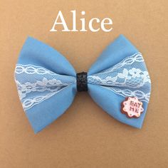 handmade Alice in wonderland hair bow by LiLSweetumsBowtique