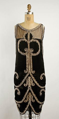 Evening dress Design House: Callot Soeurs  (French, active 1895–1937) Date: ca. 1925 Culture: French Medium: silk, metallic thread, glass Dimensions: Length: 40 1/2 in. (102.9 cm) Credit Line: Gift of Julia B. Henry, 1978
