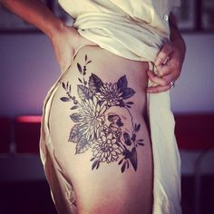 Perfect floral tattoo. love the placement.
