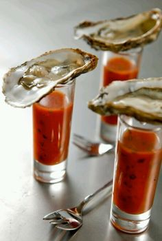 Oyster Shooter vodka oyster shots Dash of red Tabasco Dash of green Tabasco Dash of cocktail sauce Worcestershire sauce Dash of horseradish 1 ounce vodka 1 fresh, cold oyster Wedge of lemon Spicy Drinks, Yummy Drinks, Yummy Food, Yummy Lunch, Oyster Shooter, Catering, Seafood Recipes, Cooking Recipes, Sushi Recipes