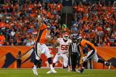 eyton Manning #18 of the Denver Broncos throws a pass during the third quarter in front of linebacker Dee Ford #55 of the Kansas City Chiefs and Ryan Harris #68 at Sports Authority Field Field at Mile High on November 15, 2015 in Denver, Colorado. The Chiefs defeated the Broncos 29-13. (Nov. 14, 2015 - Source: Justin Edmonds/Getty Images North America)