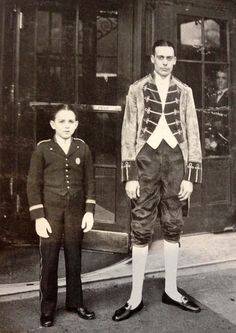 1920's. Footman and bellboy in front of The Savoy, London