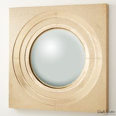 Would be gorgeous in a series on the wall.  Would love navy accents with this mirror.  Ronan Brass Mirror by Global Views