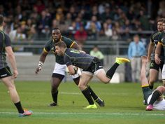 IN PICS: SOUTH AFRICA 47 WORLD XV 13 Drew Mitchell sets off on an attack