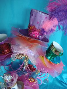 Gorgeous Mad Hatter Tea Cup Tower Centerpiece Alice in Wonderland Tea Party Bridal Shower Decoration. $225.00, via Etsy.